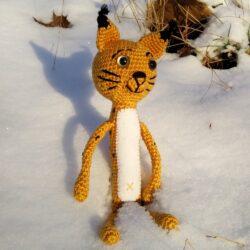Háčkovaný rys na sněhu